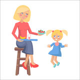 Mother Feeds her Little Daughter with Strawberries Stock Photo