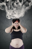 Mother feeling confused with smoke on head Royalty Free Stock Photography