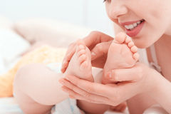 Mother and feet of a little baby Royalty Free Stock Photo
