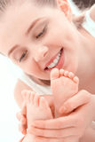 Mother and feet of a little baby Stock Photos