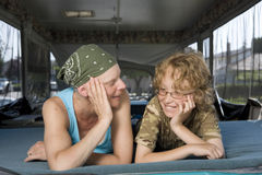 Mother fighting breast cancer talking with her son stock image
