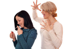 Mother finds out that her daughter smokes Stock Photography