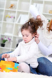 Mother fixing  Hairstyle her daughter Royalty Free Stock Photo