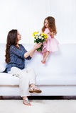 Mother with  flowers  and  daughter Royalty Free Stock Photo
