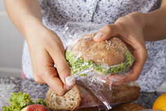 Mother foiling a sandwich stock photography