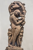 Mother fondling child - Archaeological statue made from sandstone. Royalty Free Stock Photos