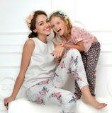Mother and four years old daughter laughing together hugging sm Stock Photography