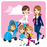 Mother Friends. Two mother friends pushing stroller walking with little baby son and child daughters Royalty Free Stock Photo