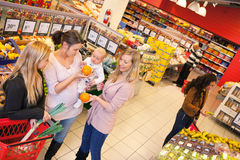 Mother and Friends in Grocery Store Stock Image