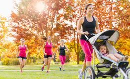 Mother and friends jogging Stock Photography