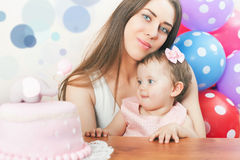 Mother with funny baby celebrating first birthday. Cake. Stock Images