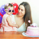 Mother with funny baby celebrating first birthday. Cake. Royalty Free Stock Photos