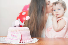 Mother with funny baby celebrating first birthday. Cake. Stock Photos