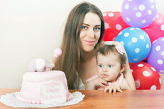 Mother with funny baby celebrating first birthday. Cake. Royalty Free Stock Photography