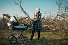 Mother in Gas Mask with Baby Carriage Stock Image