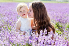 Mother and gaughter playing in lavender field Stock Photos
