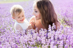 Mother and gaughter playing in lavender field Stock Photo