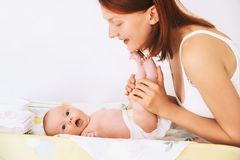 Mother gently care of baby royalty free stock photography
