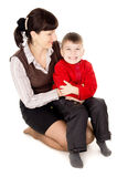 Mother gently hugs his baby Stock Photography