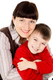 Mother gently hugs his baby Stock Image