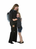 Mother getting hug from younger daughter when coming home from w Stock Photography