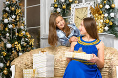 Mother with gift boxes and daughter Royalty Free Stock Image
