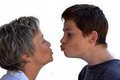 Mother and giggly  teenage son. Portraits of teenage boy and his mother having fun together, teasing each other Royalty Free Stock Photos