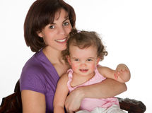Mother and girl. Little toddler girl sitting on her mother's lap royalty free stock photography