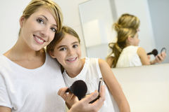 Mother and girl in bathroom royalty free stock image