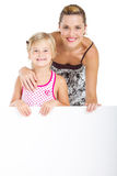 Mother girl billboard. Portrait of an adorable girl and mother holding blank billboard on white background royalty free stock photos