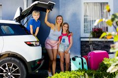 Family vacation suitcases Labrador dog girl kid baggage blue pink orange house sun summer luggage car ready holidays green trank b. Mother, girl and boy are Stock Images