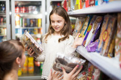 Mother with  girl buying pastry Stock Photos