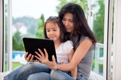 Mother and girl with E-book Royalty Free Stock Photography