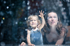 Mother and girl by fountain Stock Images