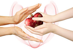 Mother with girl hands holding christmas heart Stock Photography