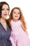 Mother and girl looking astonished Royalty Free Stock Photography