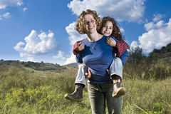 Mother girl piggyback Stock Photo