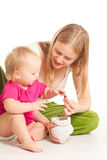 Mother and girl play with coins royalty free stock photo