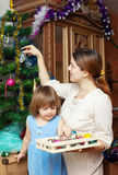 Mother and  girl preparing for  Christmas Royalty Free Stock Images