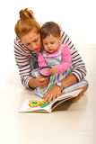 Mother with girl reading book Royalty Free Stock Photo