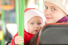 Mother with girl riding by bus Stock Photos