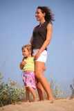 Mother with girl on sand Stock Photography
