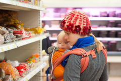 Mother with girl shopping in supermarket stock photos