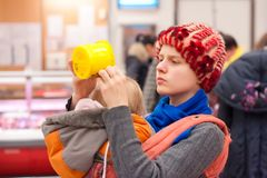 Mother with girl shopping in supermarket Royalty Free Stock Image