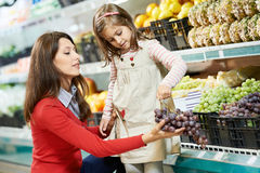 Mother and girl shopping in supermarket Royalty Free Stock Images