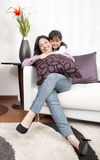 Mother and girl smiling in the home Stock Photos