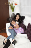 Mother and girl smiling home Royalty Free Stock Images
