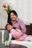 Mother and girl smiling in the living room Royalty Free Stock Photography