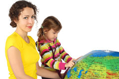 Mother and girl with stethoscope and big globe Stock Photos