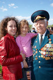 Mother, girl and veteran of Great Patriotic War. MOSCOW - MAY 9: Mother, little daughter and veteran of Great Patriotic War in the uniform stand together on Royalty Free Stock Images